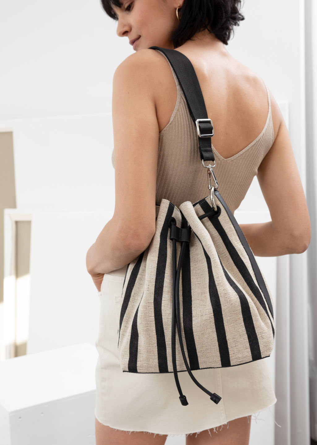 Back image of Stories striped bucket bag in beige