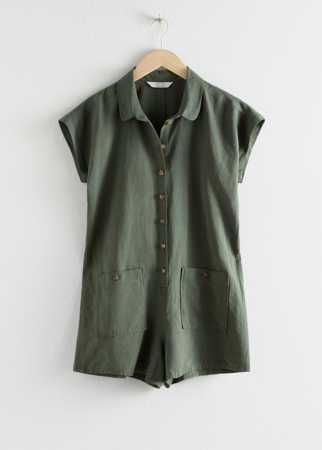 Front image of Stories linen blend relaxed fit romper in green