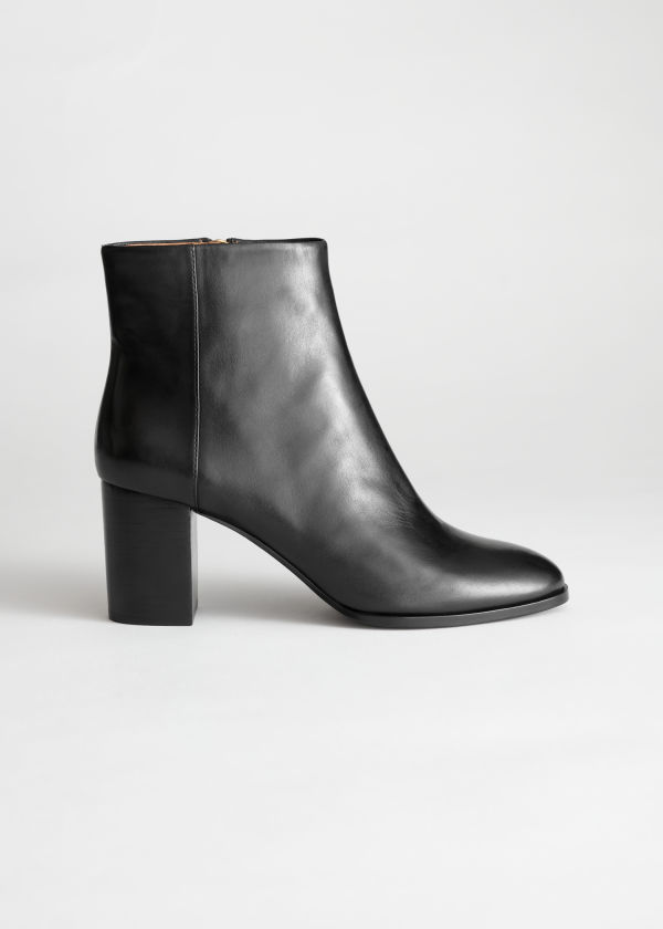 Front image of Stories leather ankle boots in black