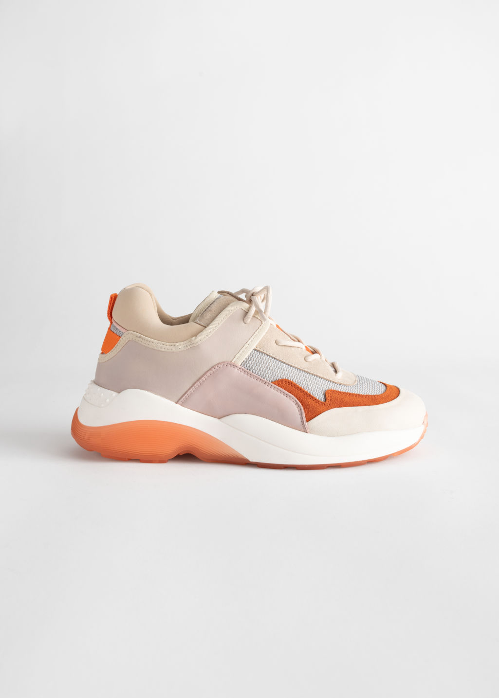 Front image of Stories trio colour block chunky sneakers in orange