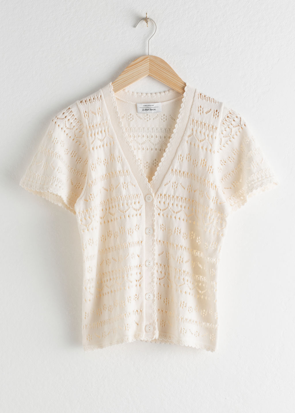 Front image of Stories cotton crochet short sleeve cardigan in white