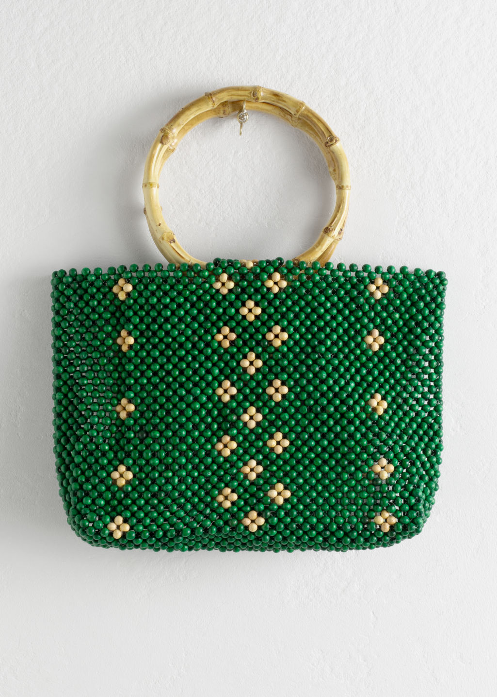 Front image of Stories wooden beaded circle handle bag in green