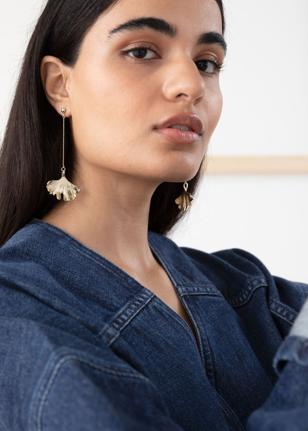 Back image of Stories ginkgo leaf hanging earrings in gold