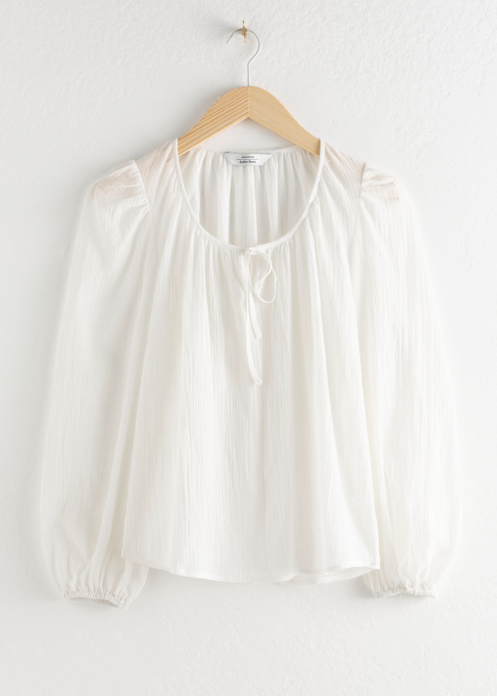 StillLife Front Image of Stories Puff Sleeve Knot Tie Blouse in White