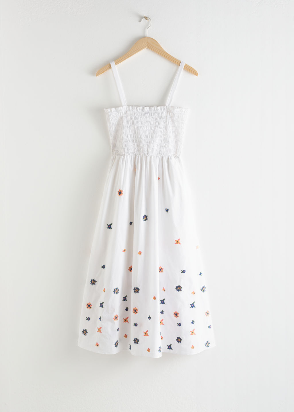 Front image of Stories embroidered smocked midi dress in white