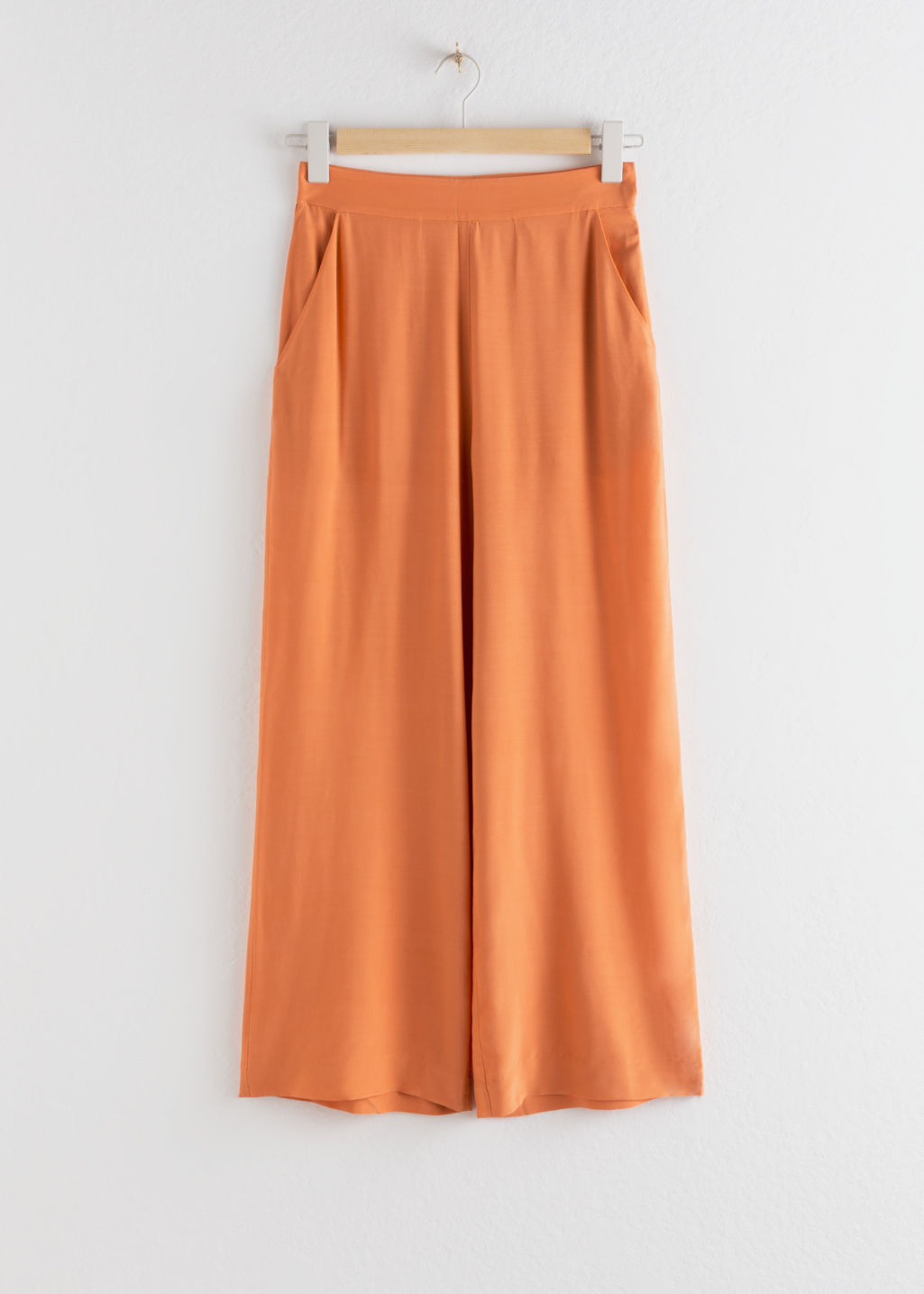 Front image of Stories high waisted flared trousers in orange
