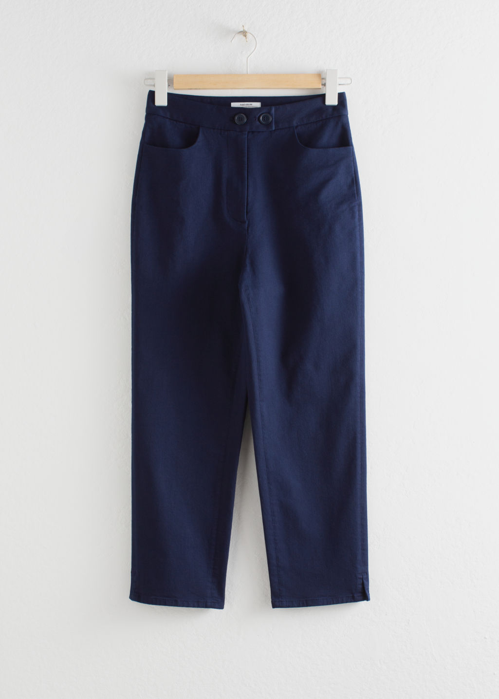 Front image of Stories cropped tailored trousers in blue