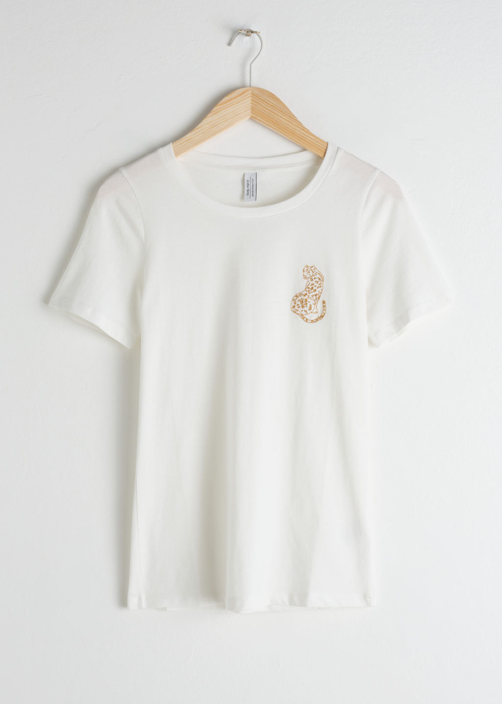 Front image of Stories leopard embroidered cotton tee in white
