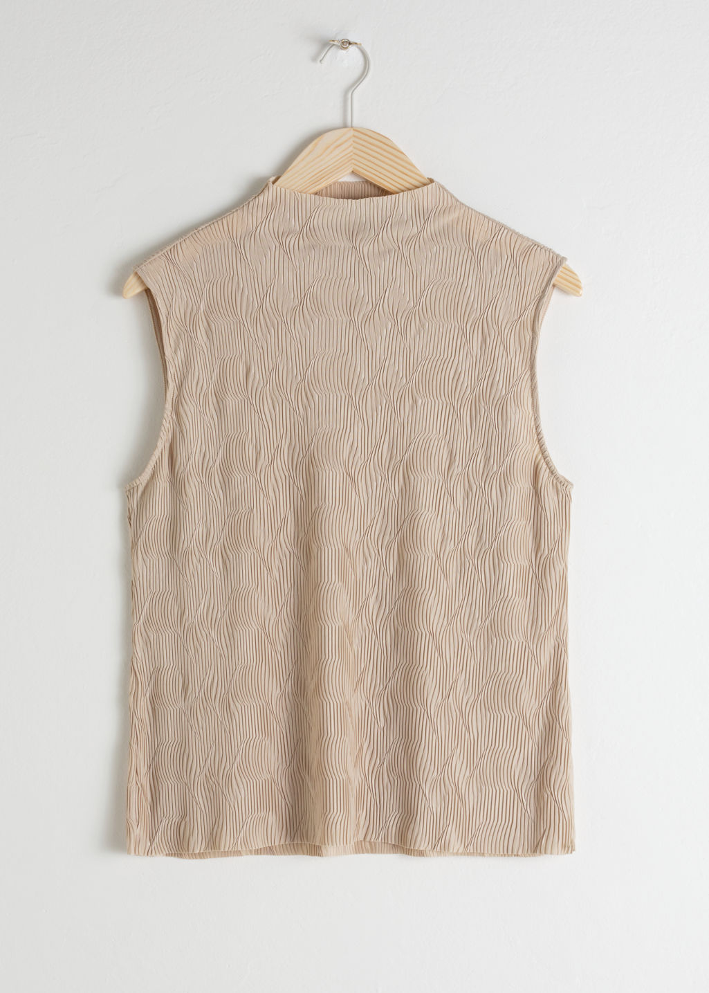 Front image of Stories plissé pleated mock neck tank in beige