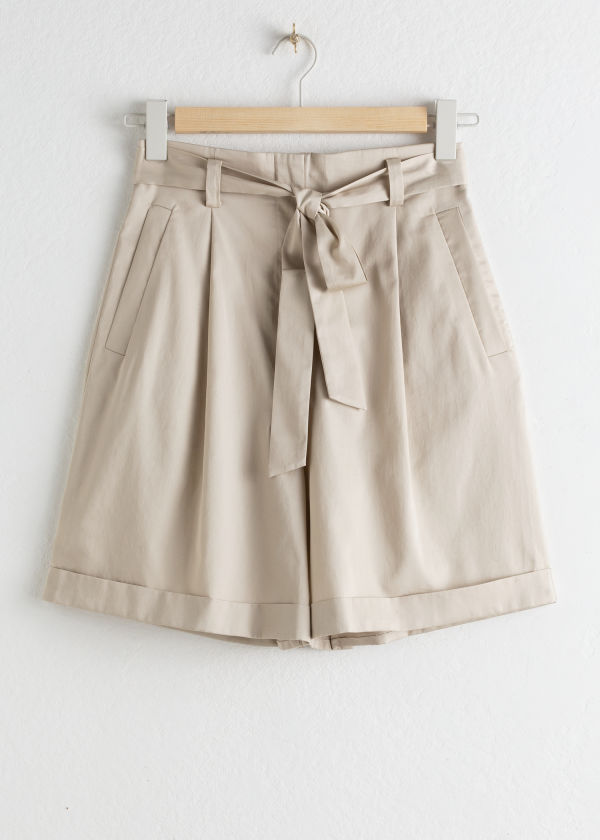 Front image of Stories high waisted belted cotton shorts in beige