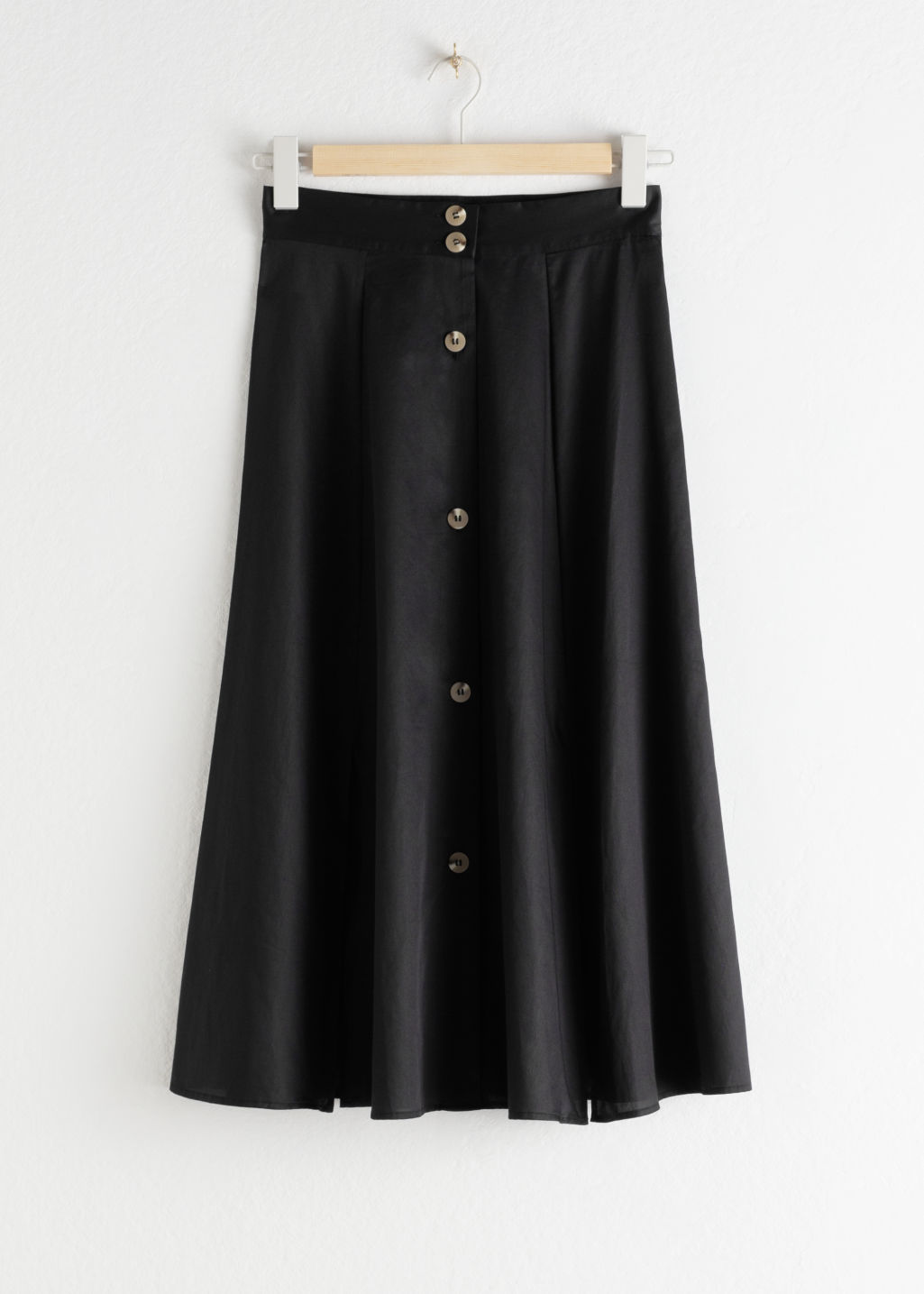 Front image of Stories striped flared midi skirt in black