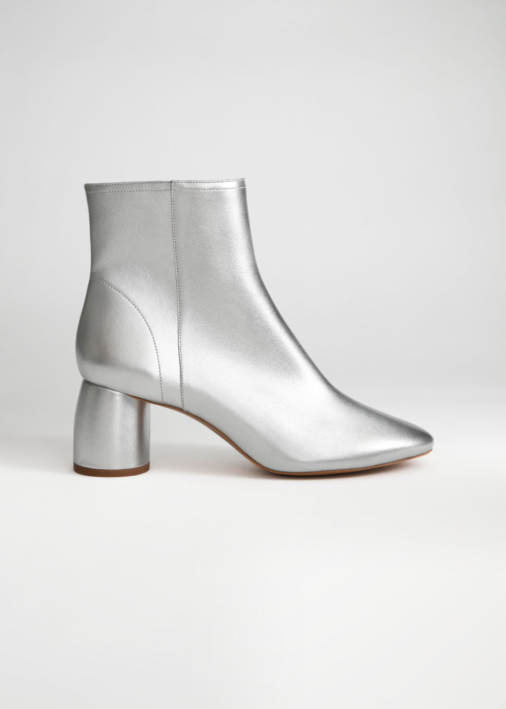 Front image of Stories metallic cylinder heel boots in silver