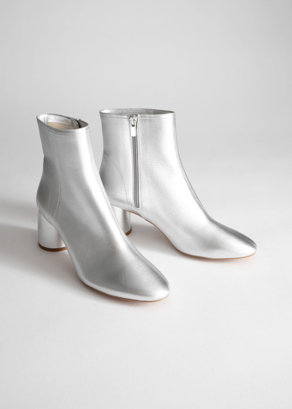 Back image of Stories metallic cylinder heel boots in silver
