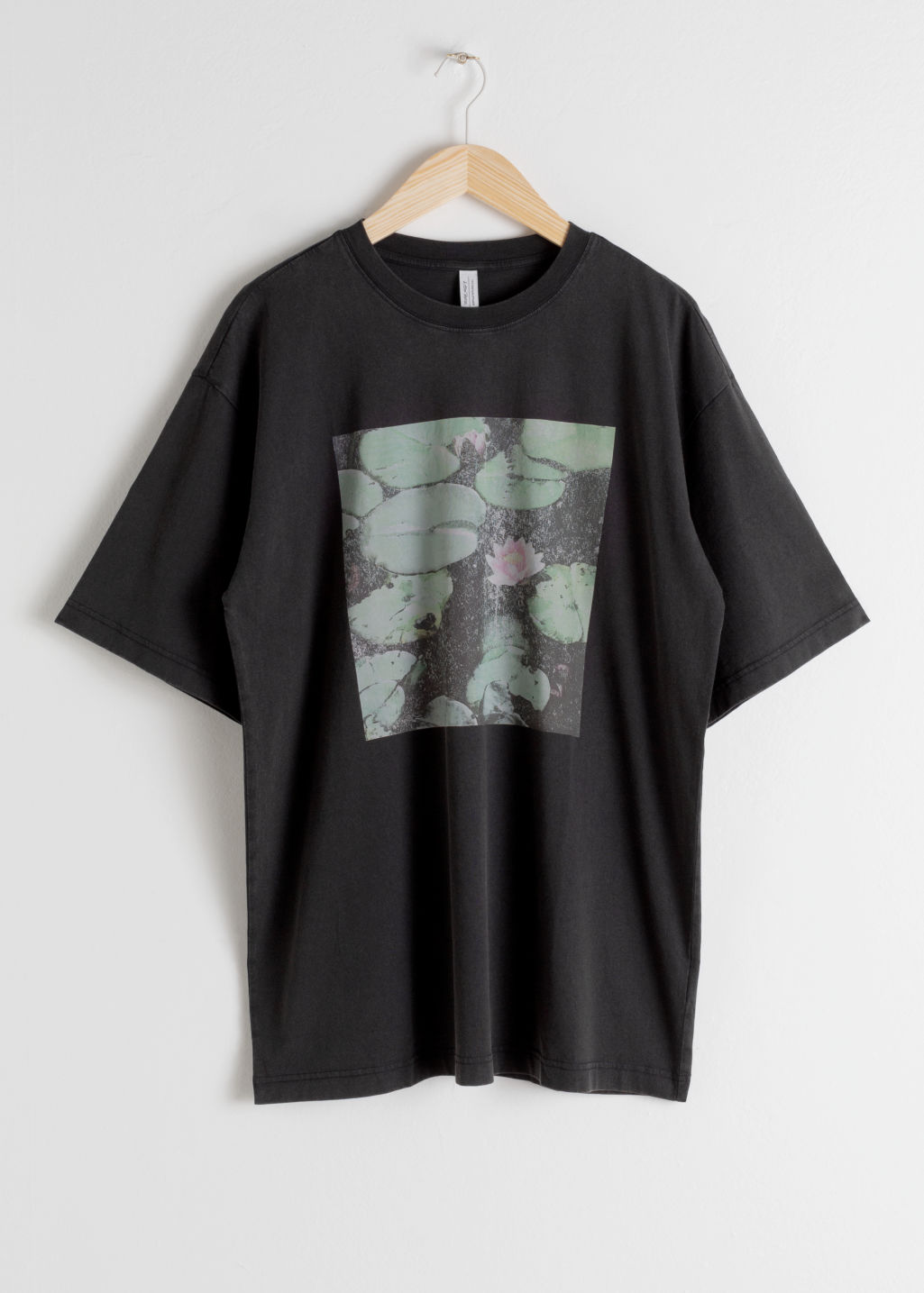Front image of Stories graphic boyfriend fit tee in black