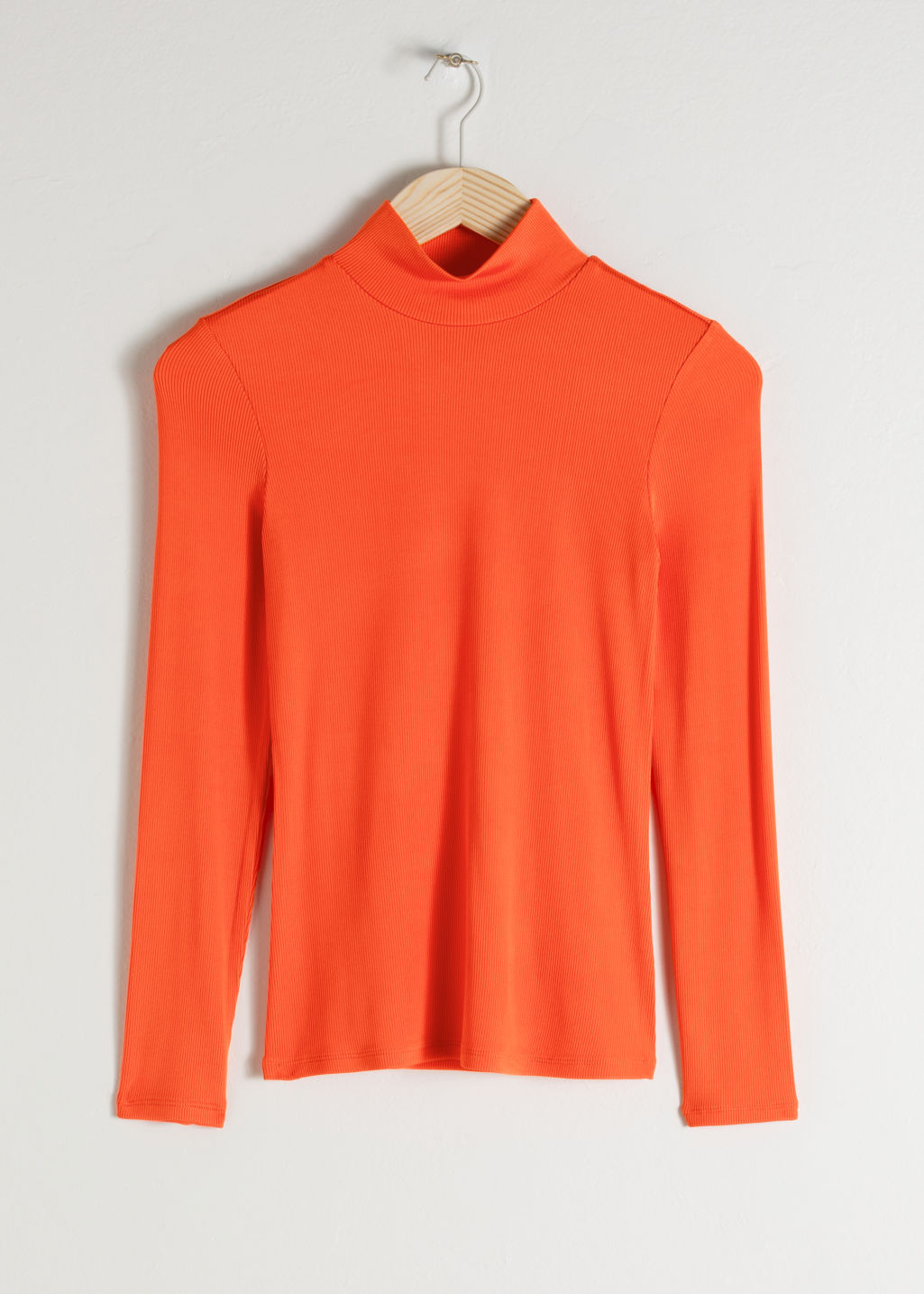Front image of Stories fitted long sleeve turtleneck  in orange