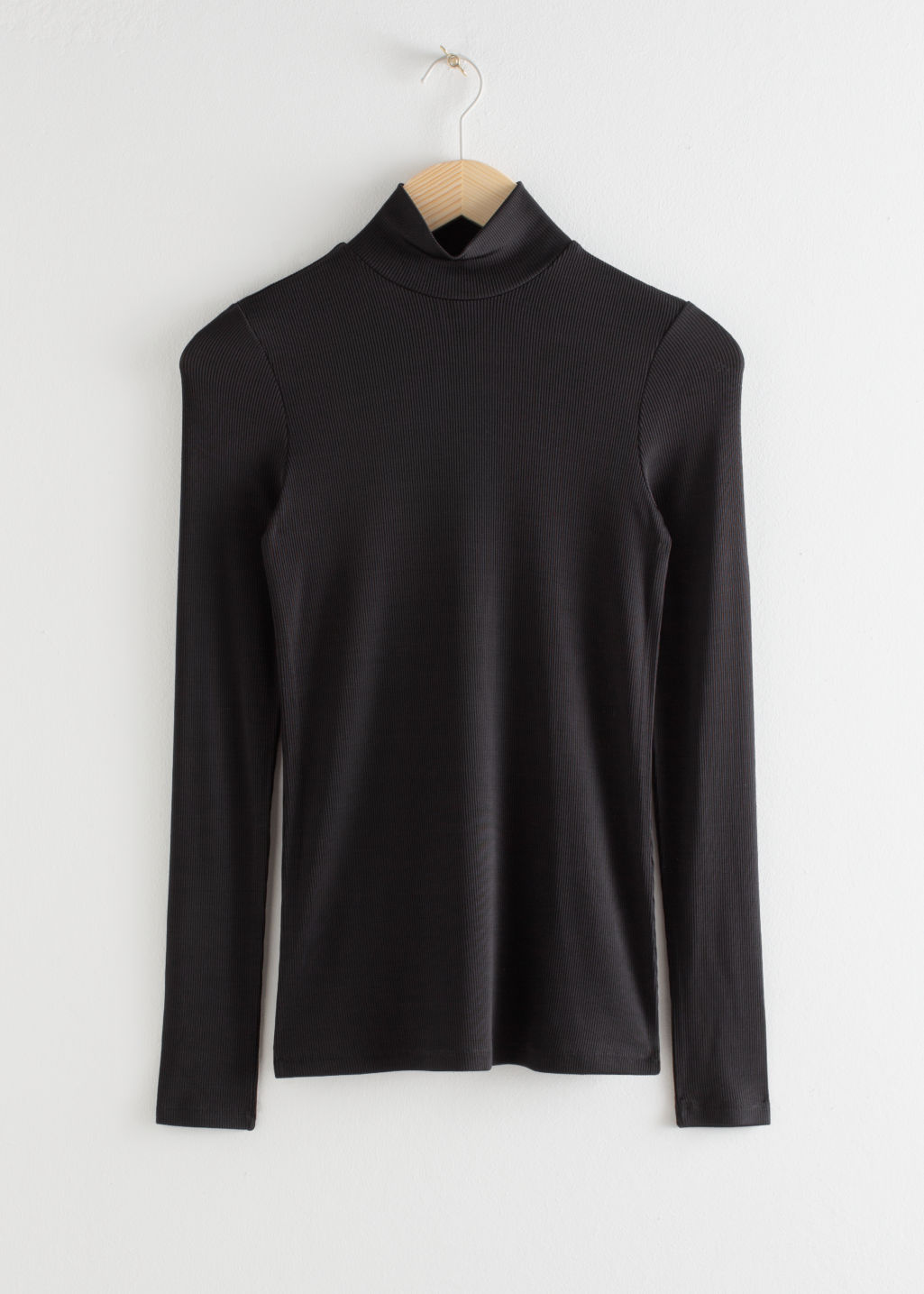 Front image of Stories fitted long sleeve turtleneck  in black
