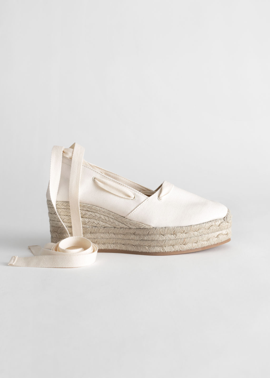 Front image of Stories lace up espadrille wedges in white