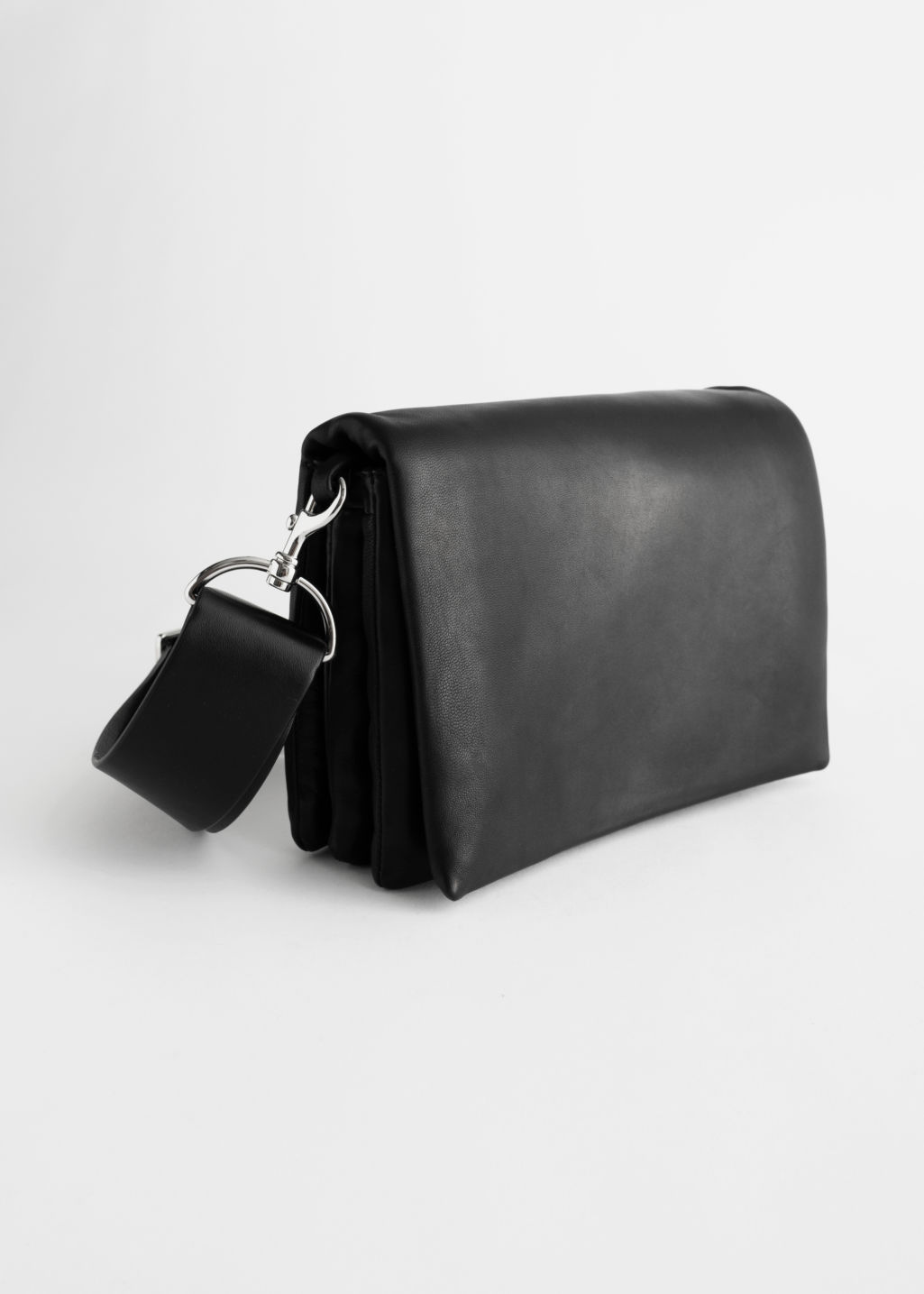 StillLife Front Image of Stories Leather Crossbody Utility Bag in Black