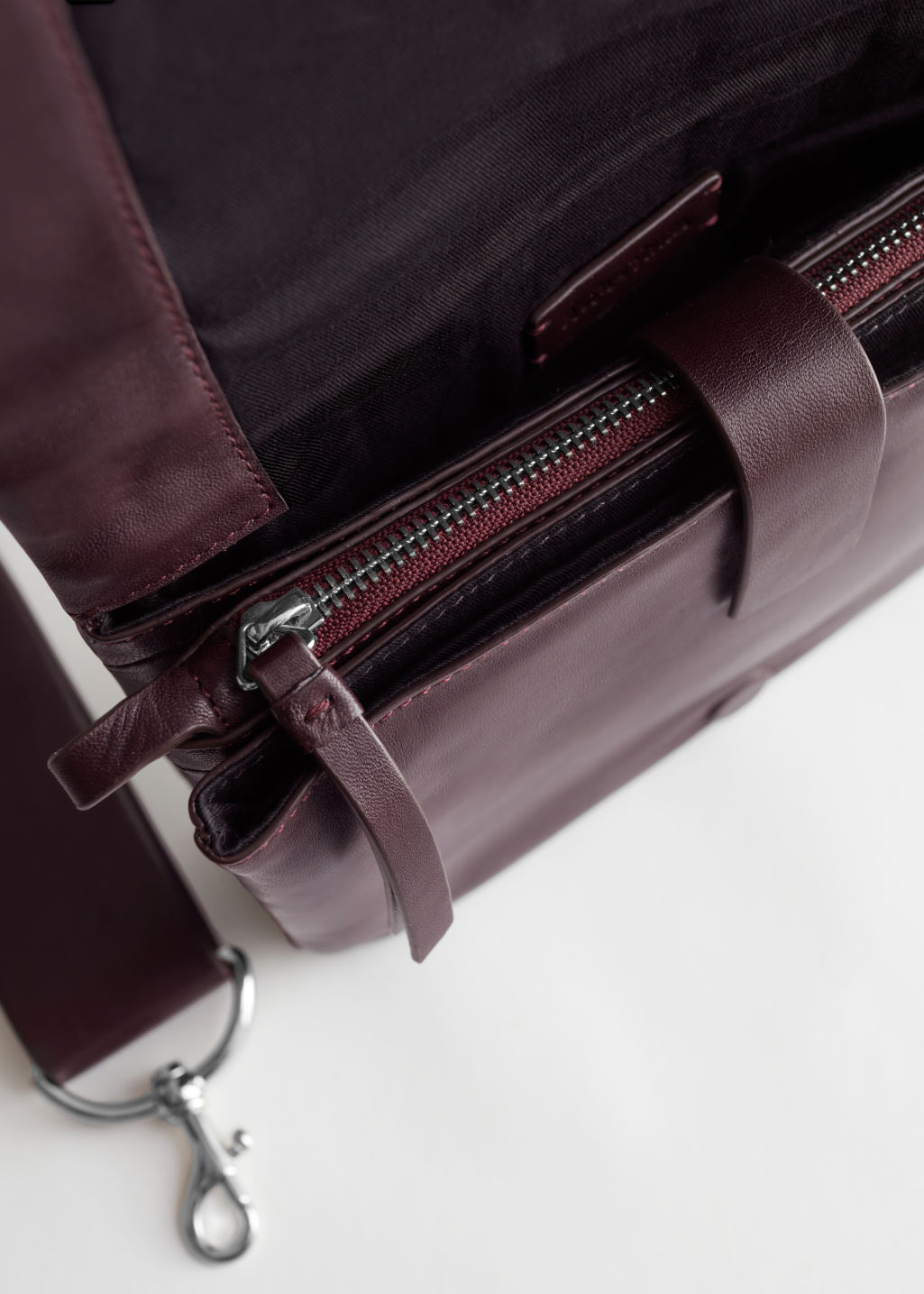 Side image of Stories leather crossbody utility bag in red
