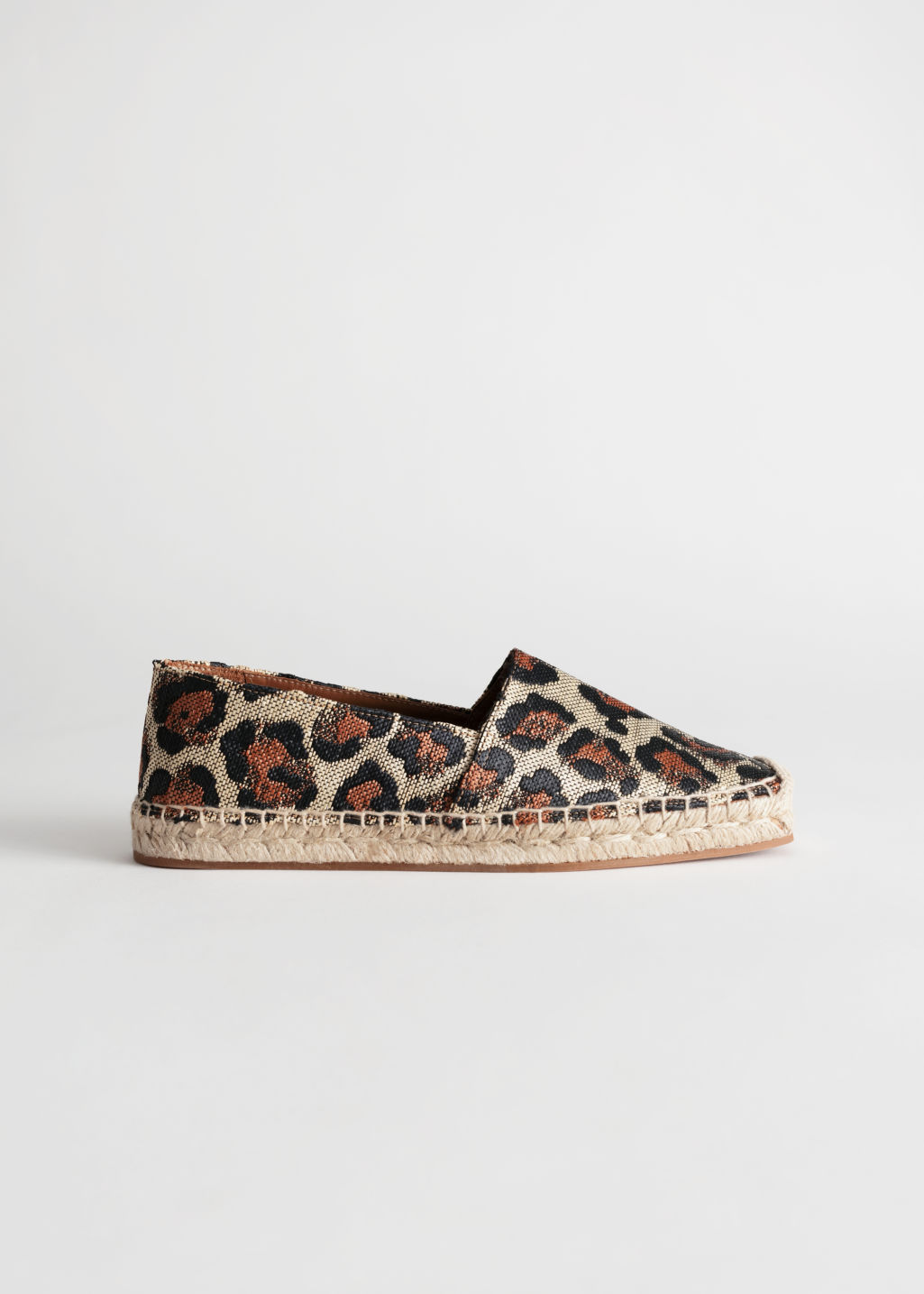 Front image of Stories square toe leopard espadrilles in orange