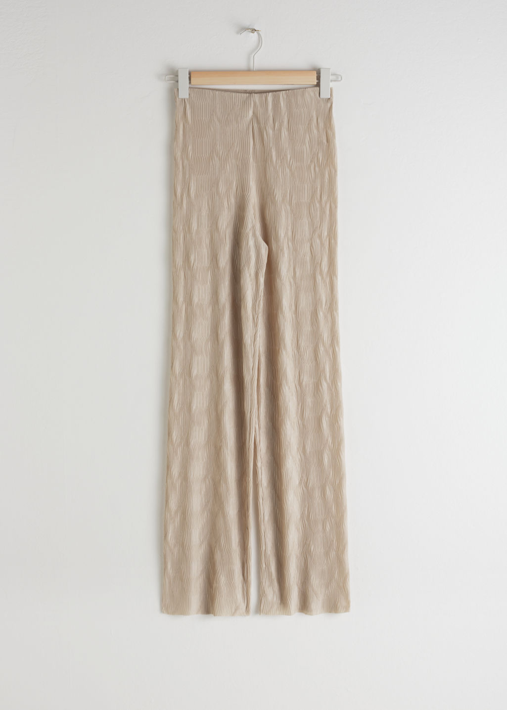Front image of Stories plissé pleated fitted trousers in beige