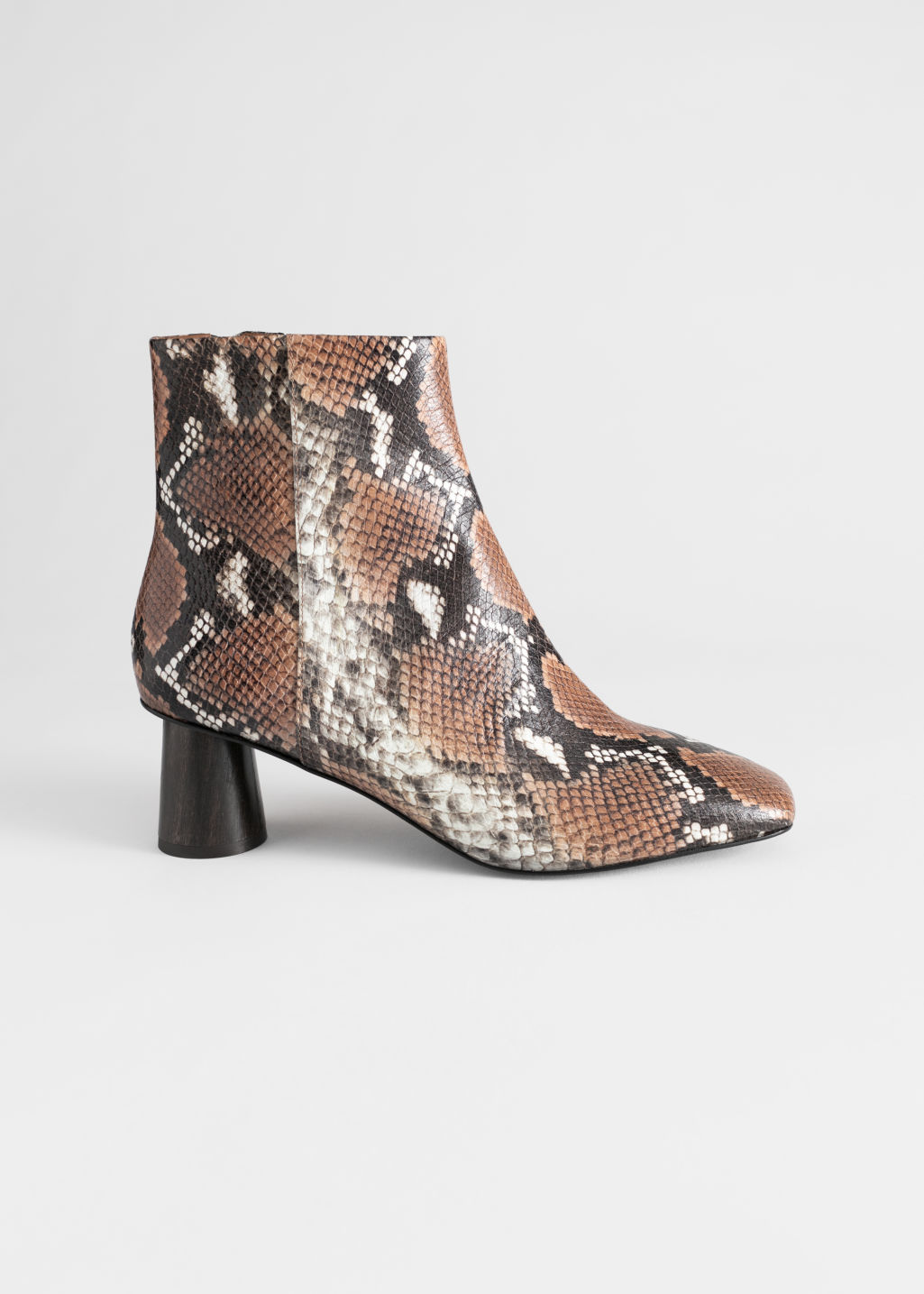 Front image of Stories wooden heel snake ankle boots in yellow