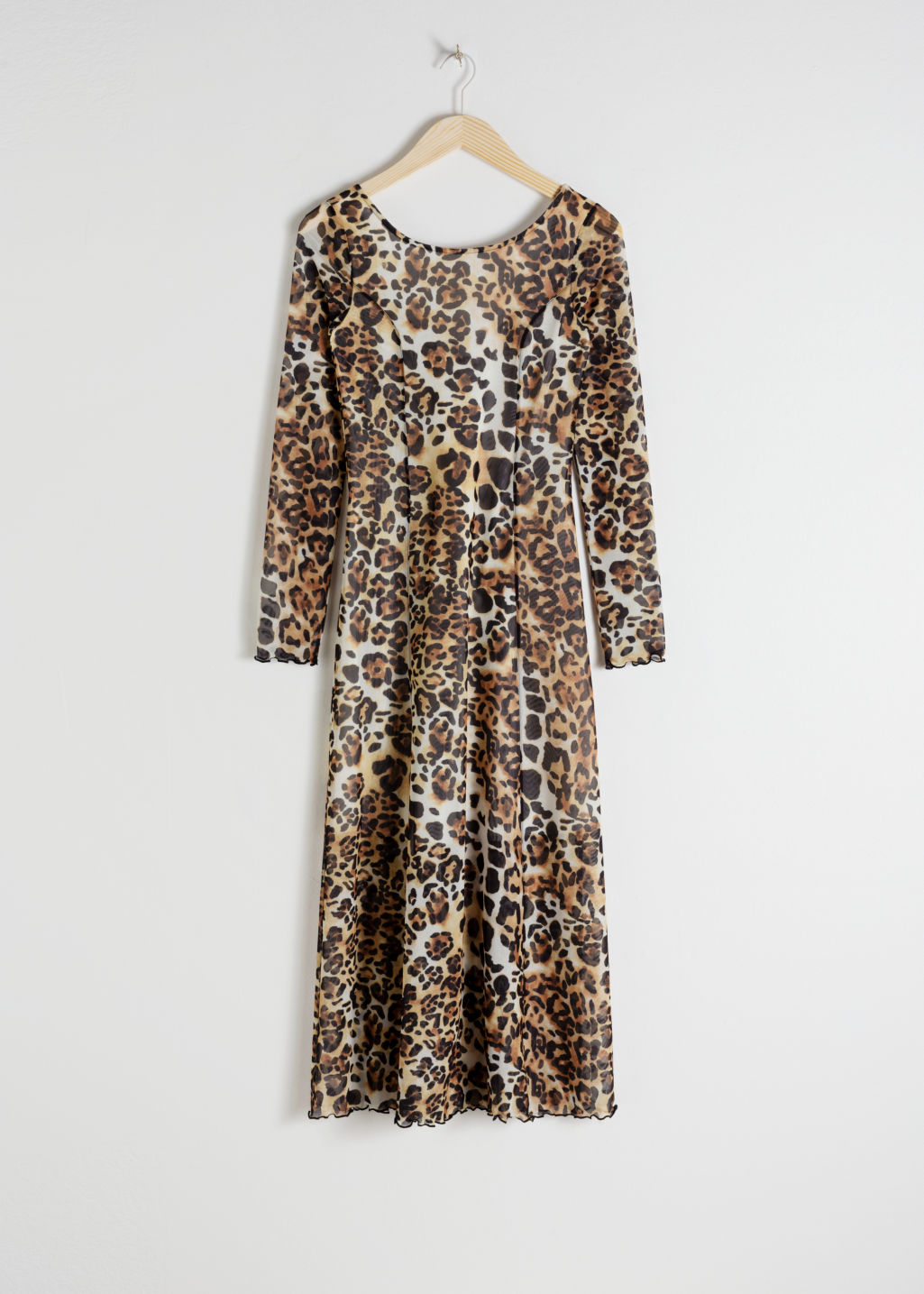 Front image of Stories mesh cheetah midi dress in white
