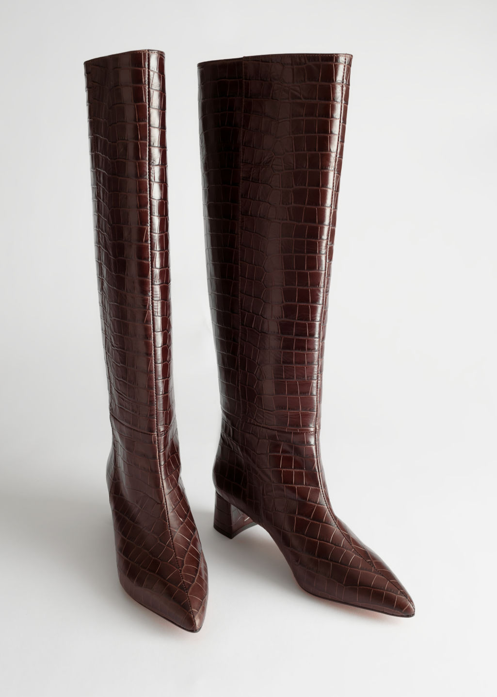 Front image of Stories croc leather knee high boots in orange