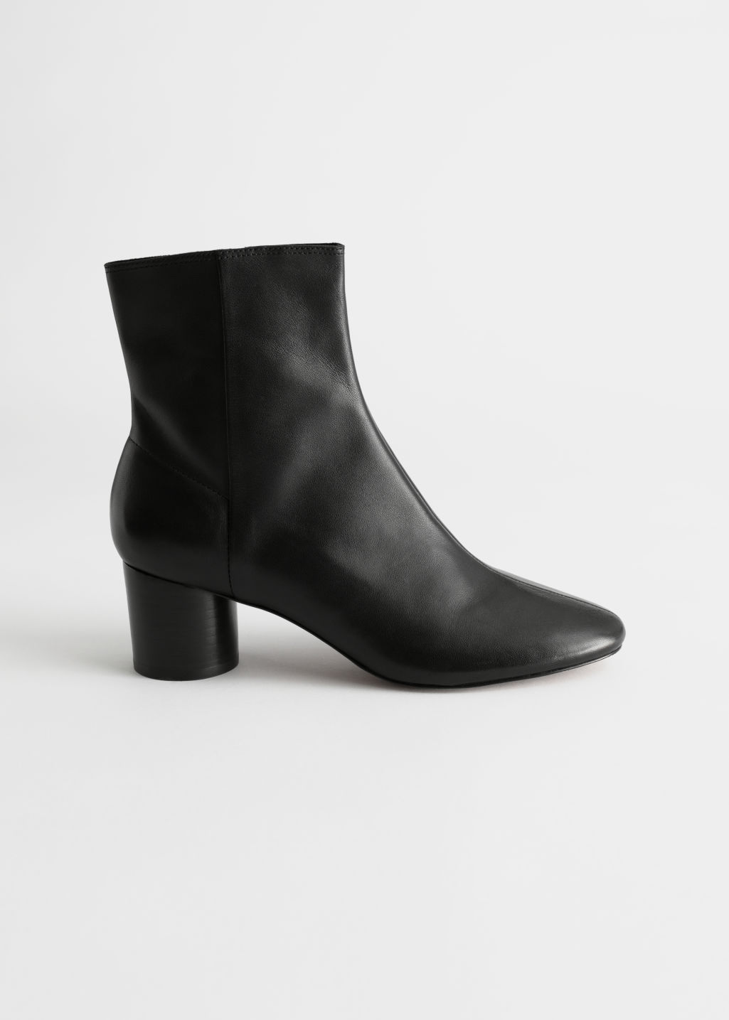 Front image of Stories leather round toe ankle boots in black