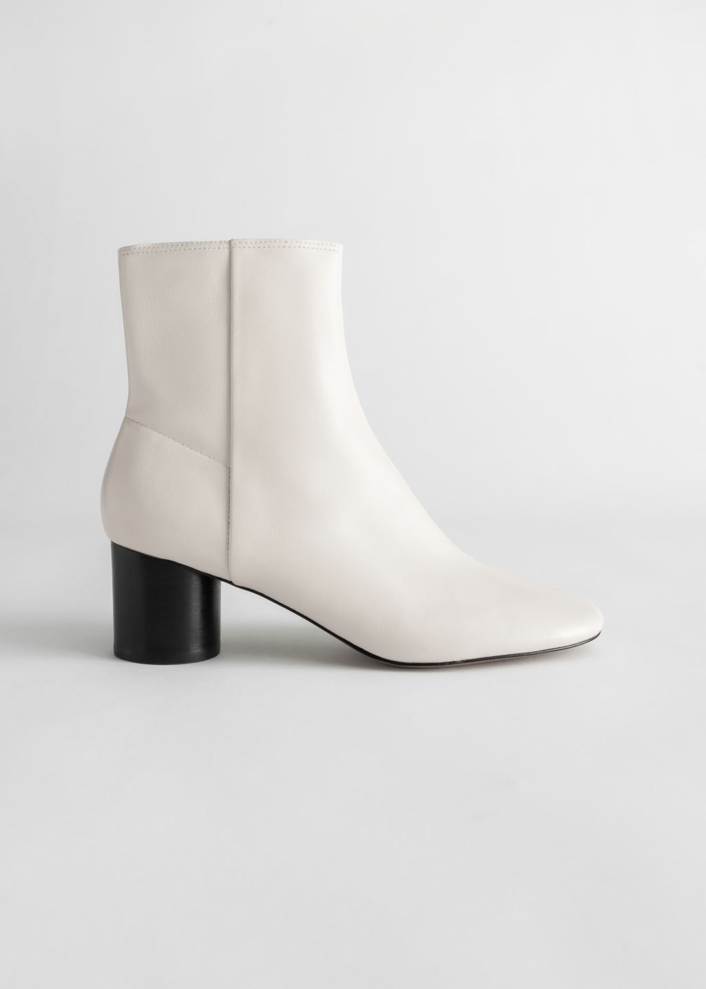 Front image of Stories leather round toe ankle boots in white