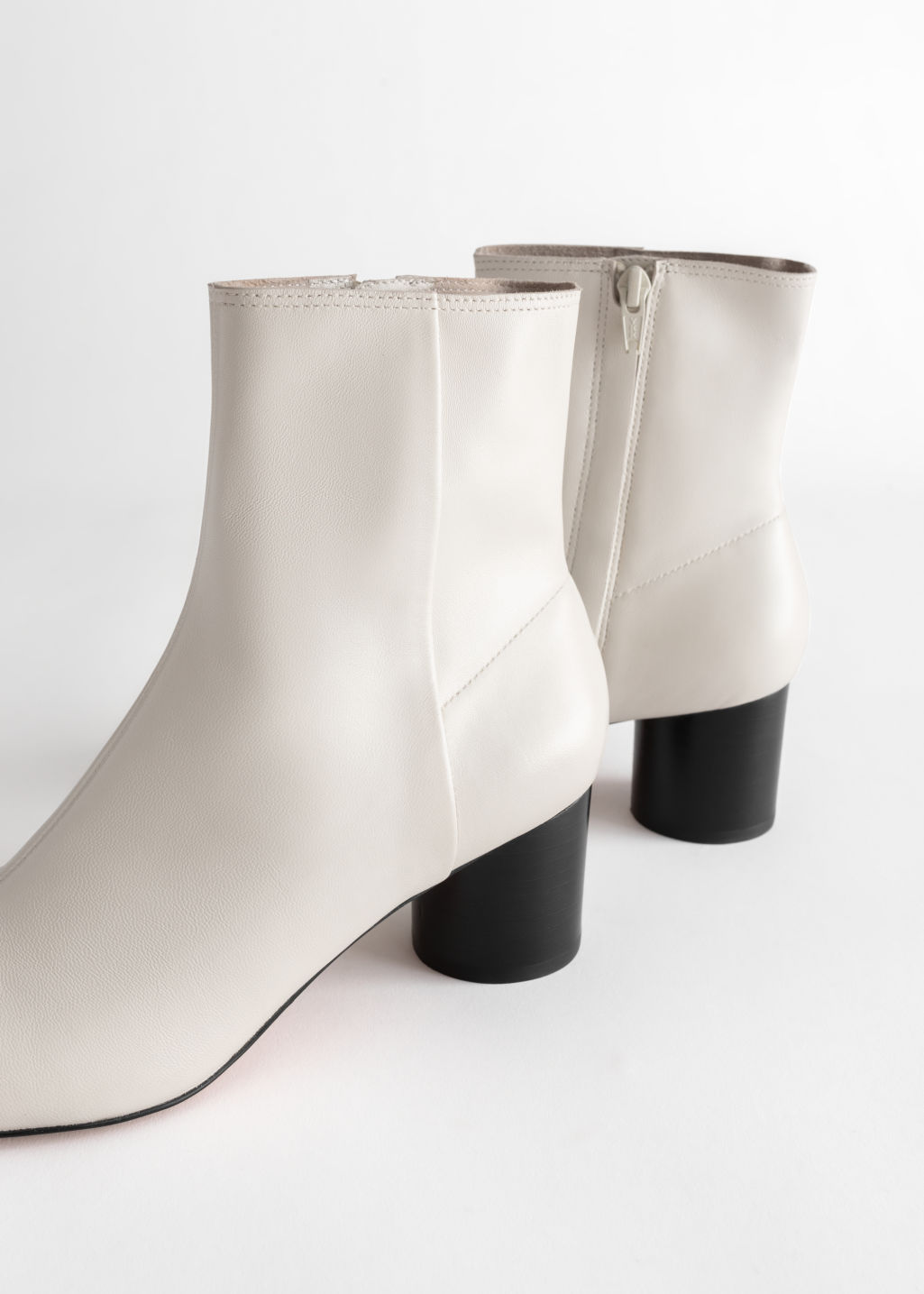 Back image of Stories leather round toe ankle boots in white