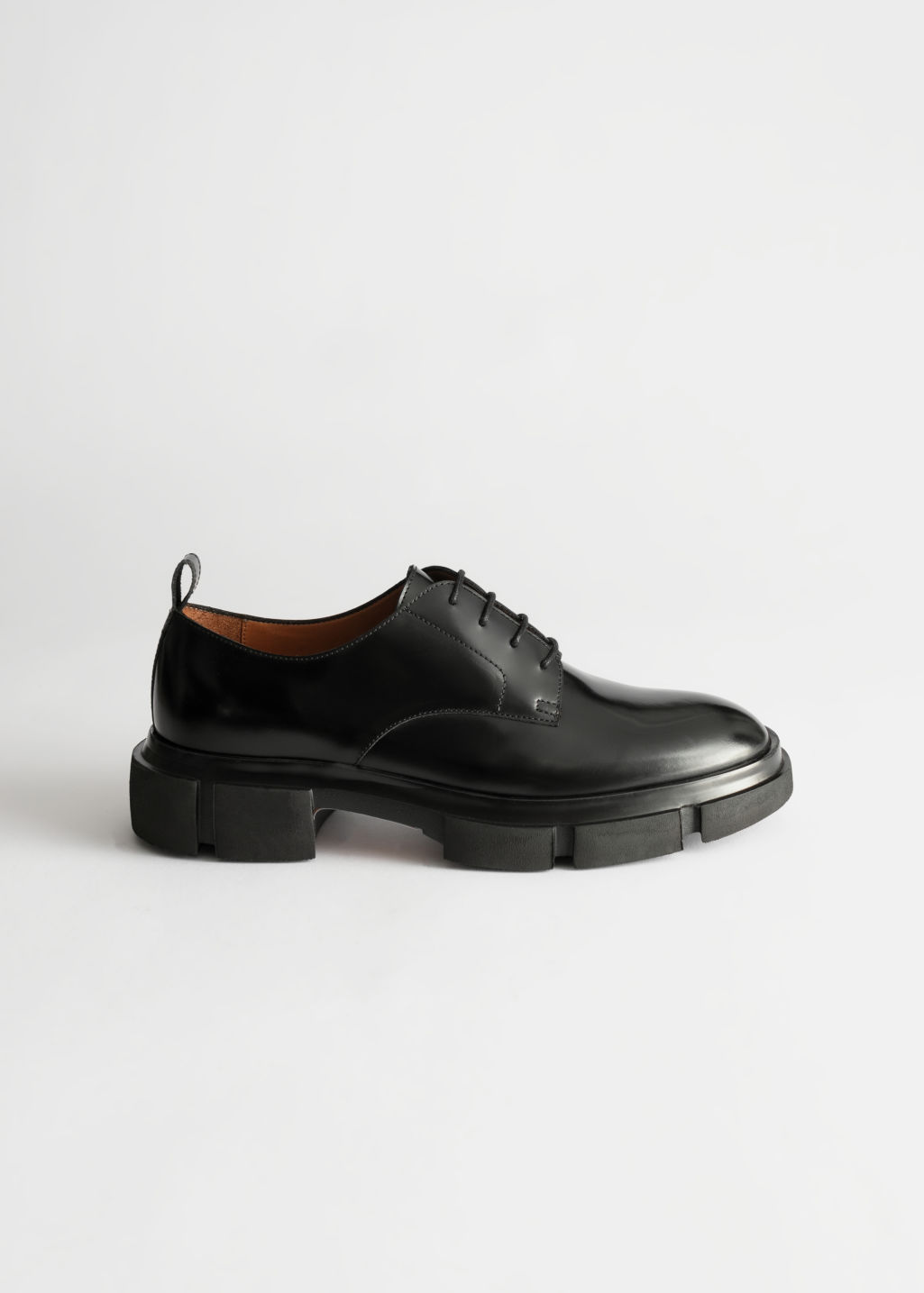 Front image of Stories technical chunky sole oxfords in black