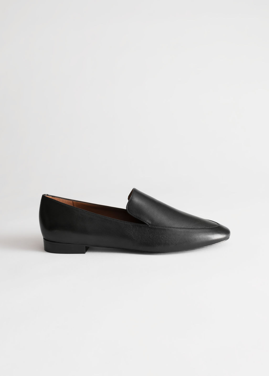 Front image of Stories smooth leather classic loafers in black