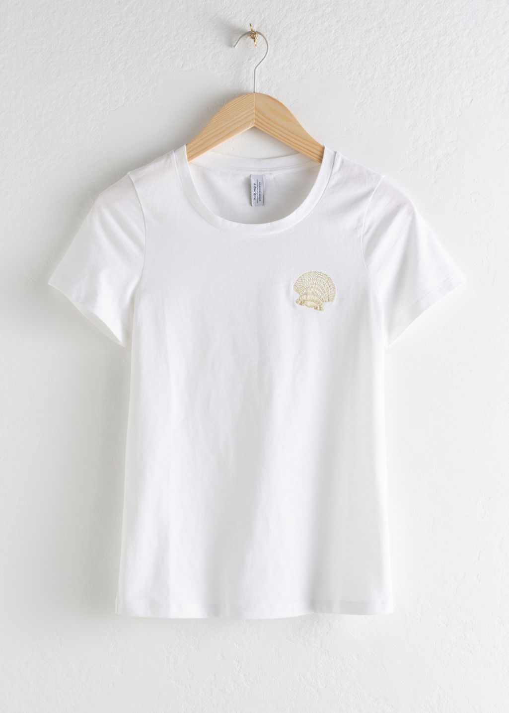 Front image of Stories seashell embroidered tee in white