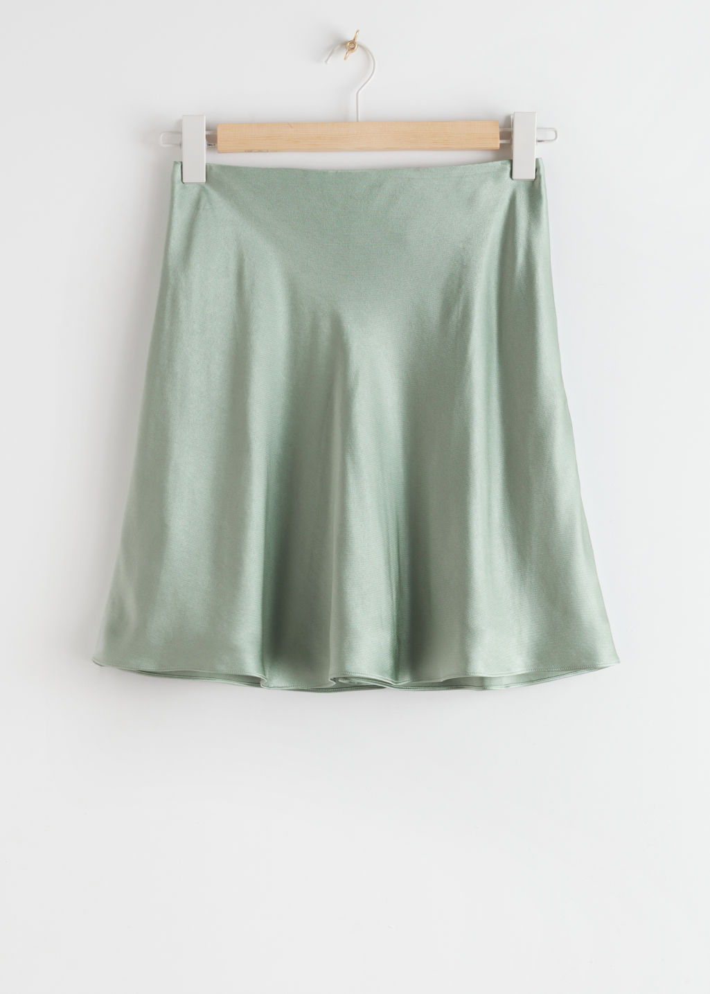 StillLife Front Image of Stories Satin Mini Skirt in Green