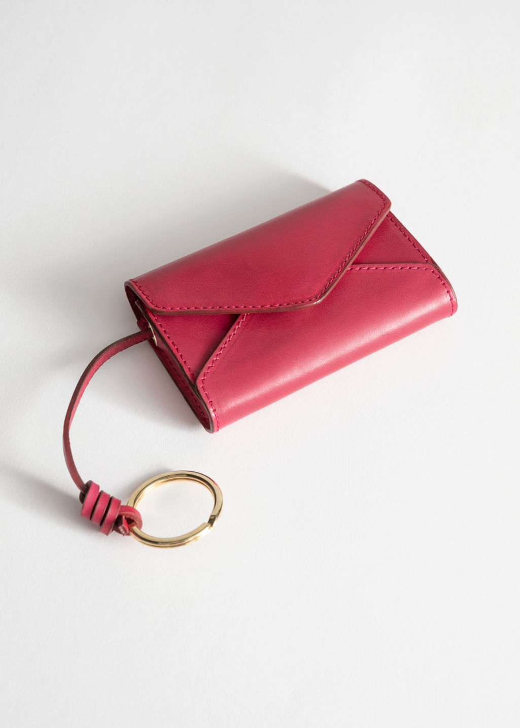Front image of Stories leather envelope key pouch in pink
