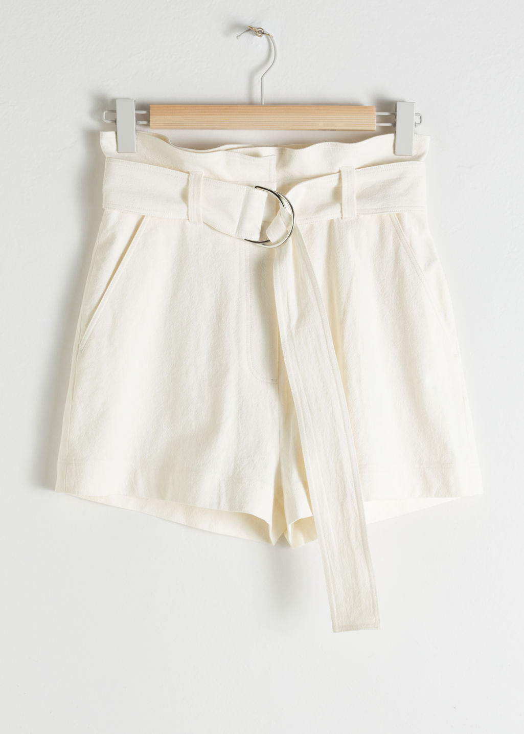 Front image of Stories cotton linen belted shorts in white