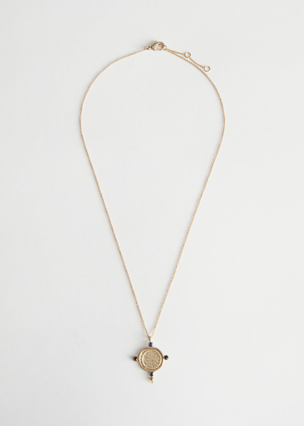 Front image of Stories coin arrow pendant necklace in gold