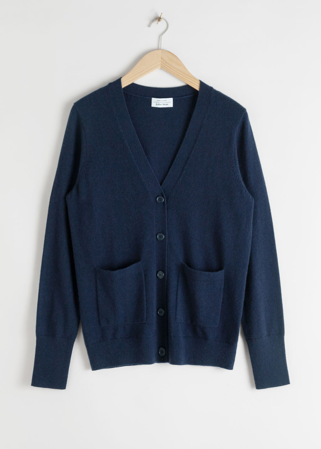 Front image of Stories duo pocket cashmere cardigan  in blue