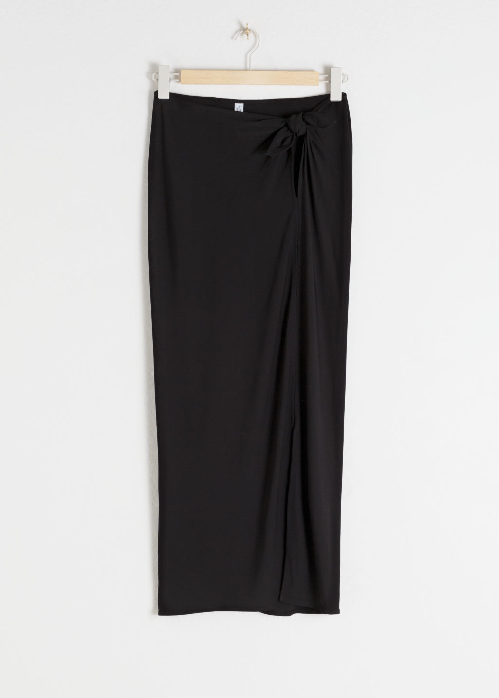 Front image of Stories side tie midi skirt in black