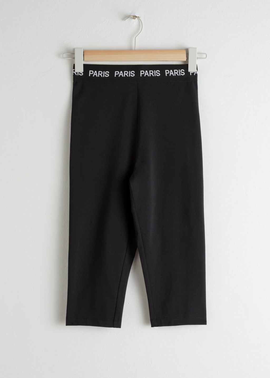 Front image of Stories fitted stretch cotton cycling shorts in black