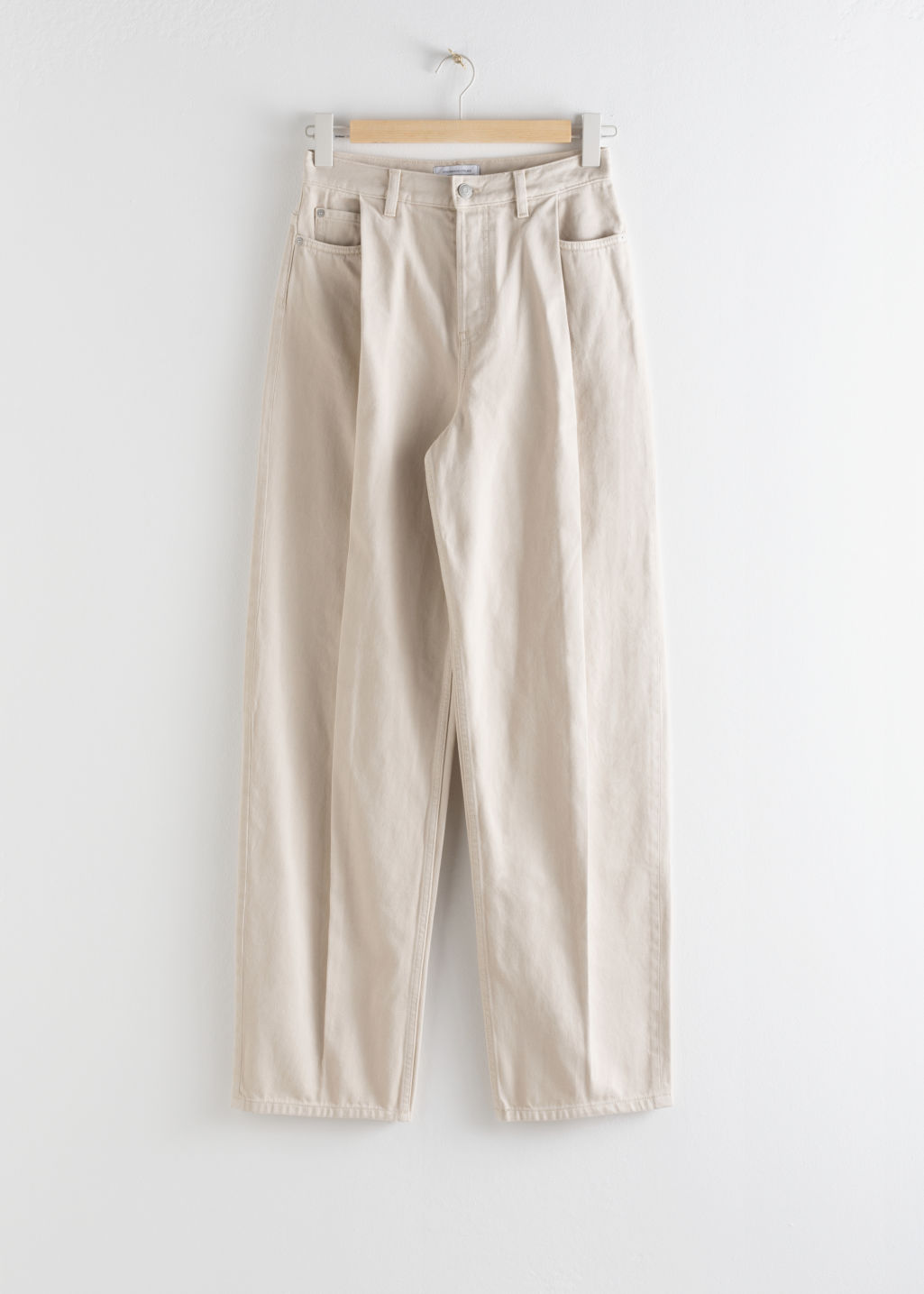 Front image of Stories relaxed high rise pleat jeans in beige
