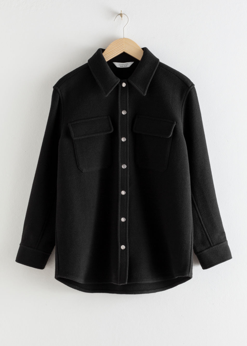 Front image of Stories oversized wool blend workwear shirt in black