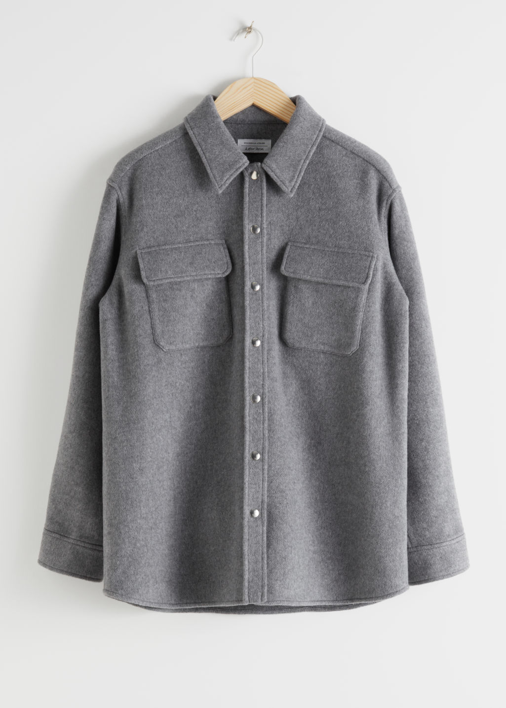 Front image of Stories oversized wool blend workwear shirt in grey