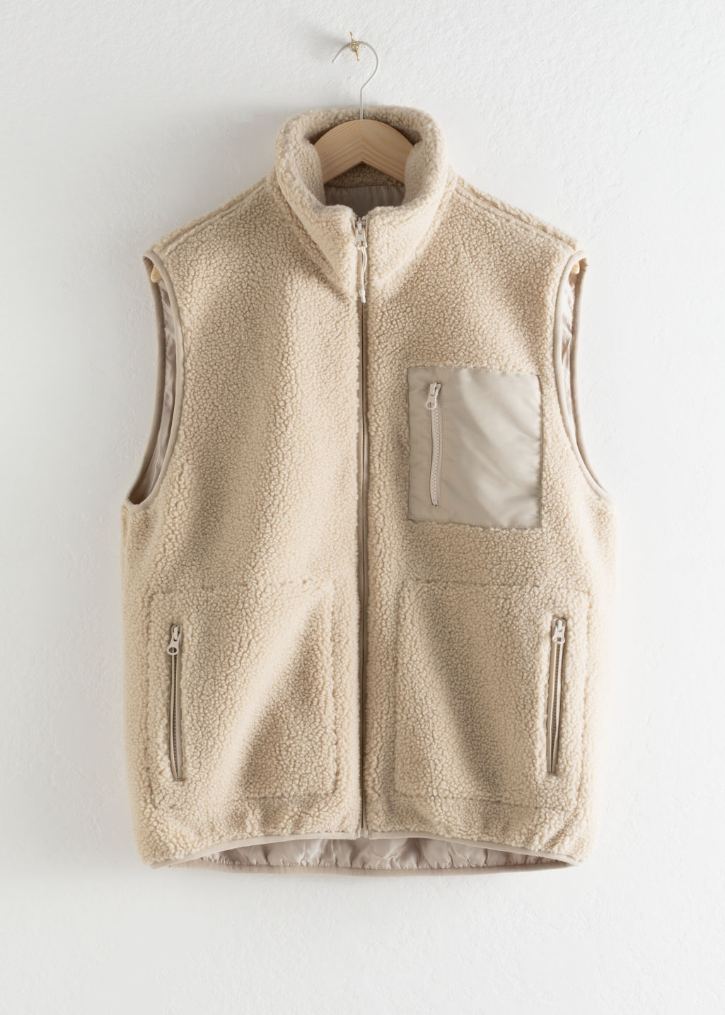 Front image of Stories faux shearling utility vest in beige
