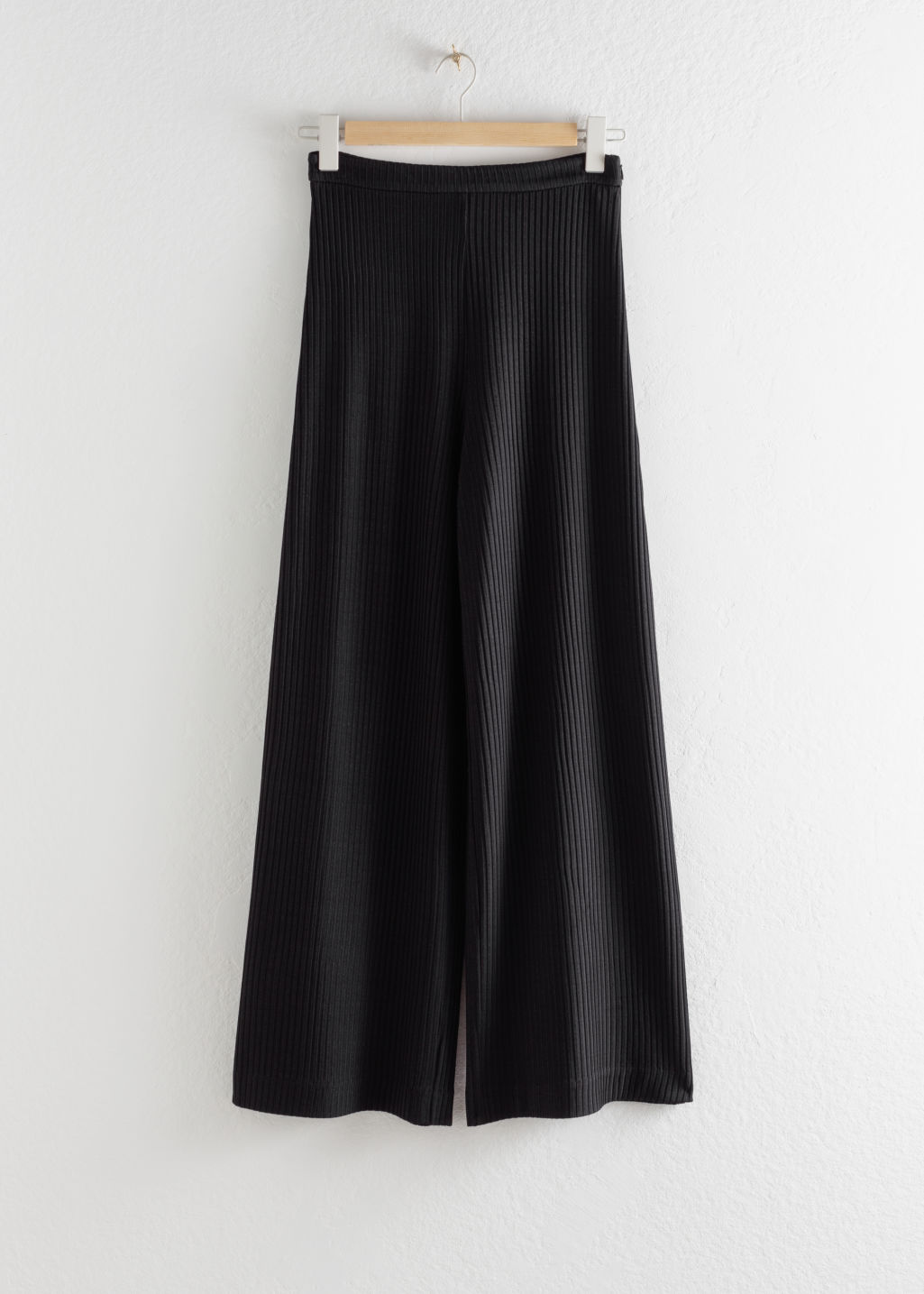 Front image of Stories stretch rib trousers in black