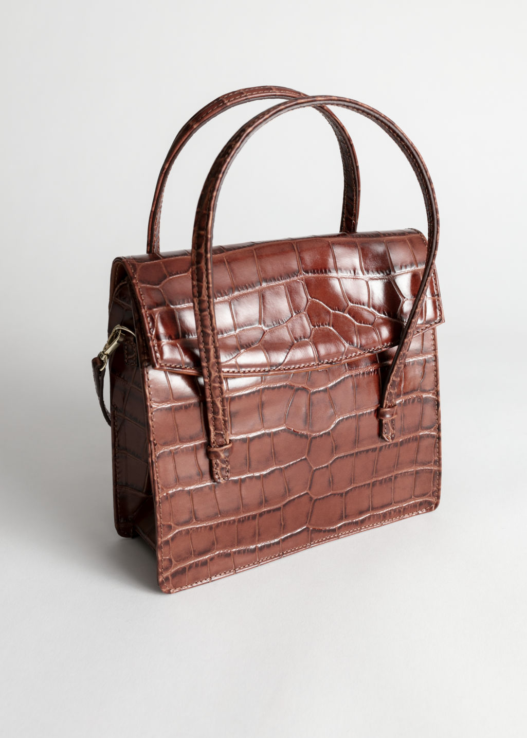 Front image of Stories leather croc square crossbody bag in brown