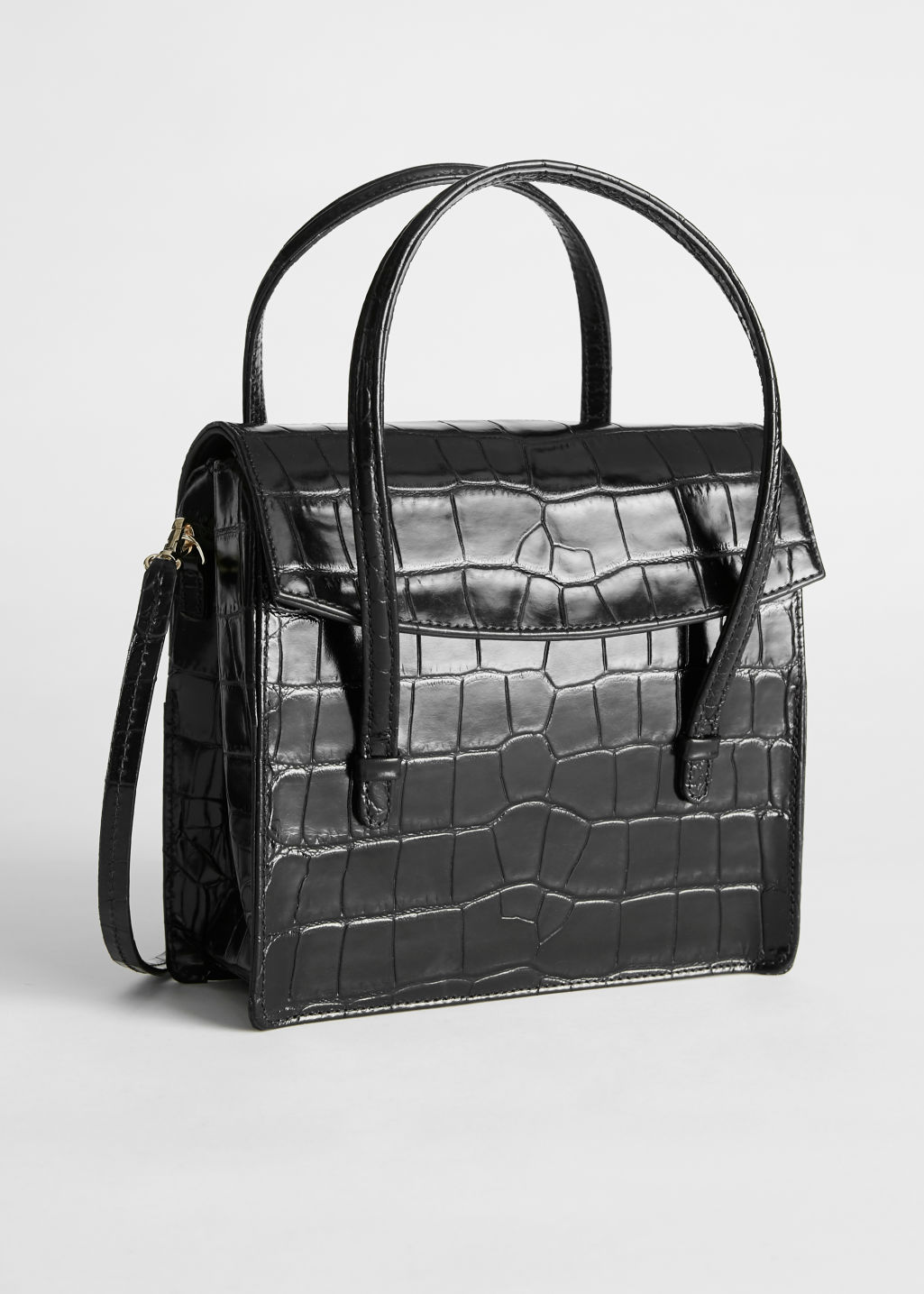 Front image of Stories leather croc square crossbody bag in black