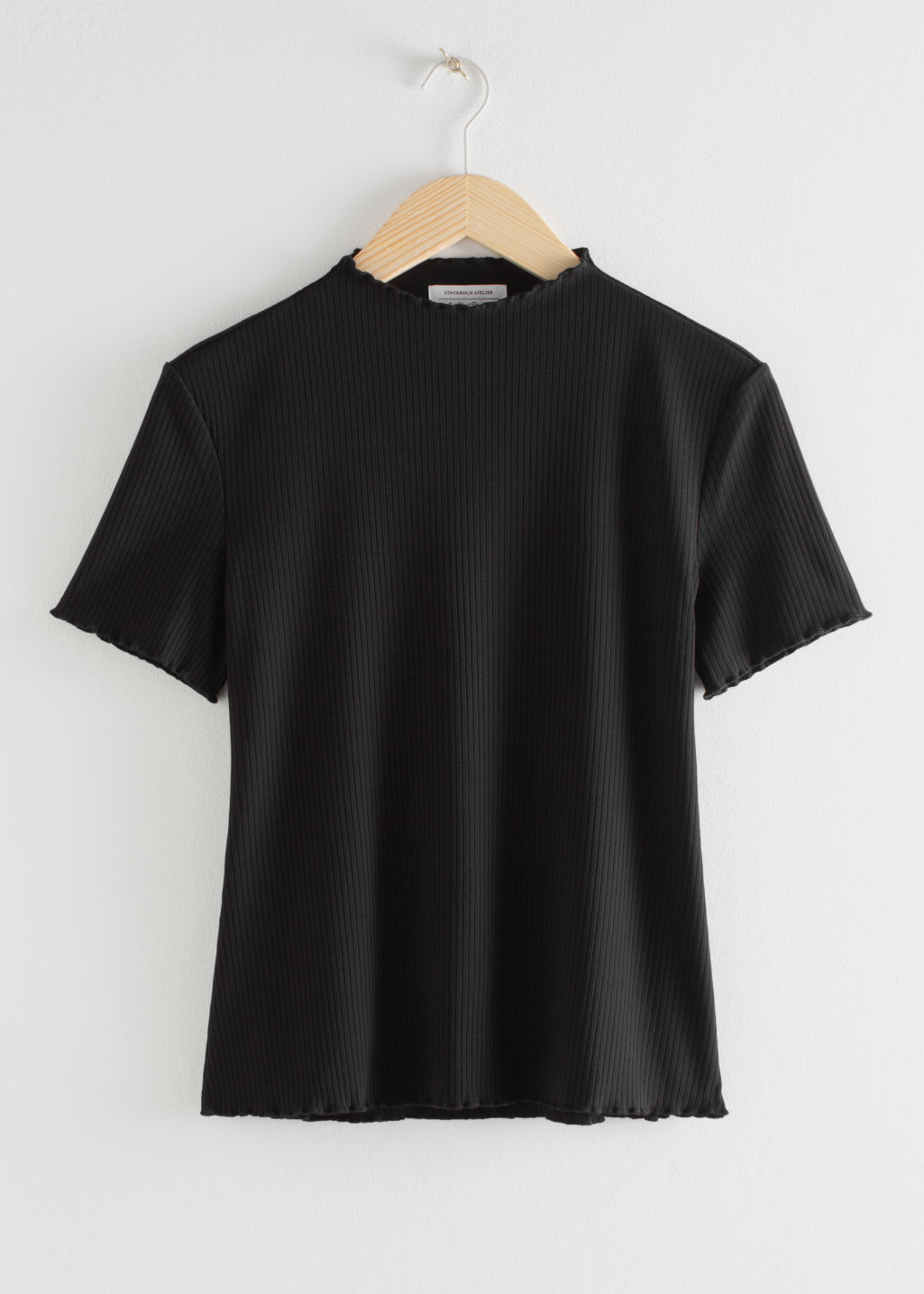 Front image of Stories stretch rib knit top in black