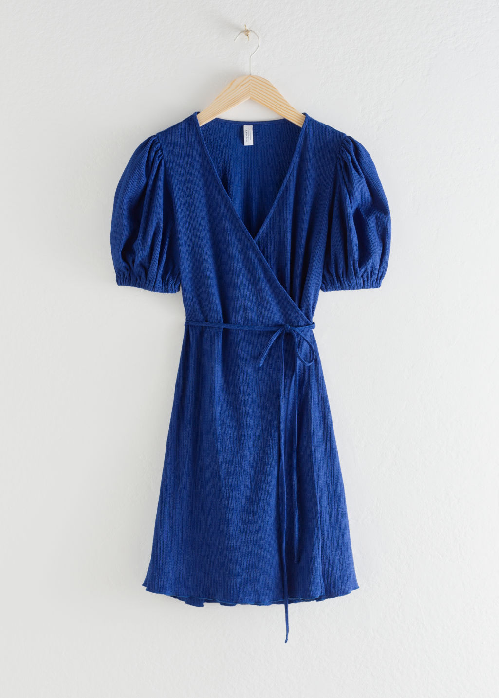 Front image of Stories puff sleeve ribbed mini wrap dress in blue
